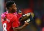 Raheem Sterling with his daughter and a supporters' award