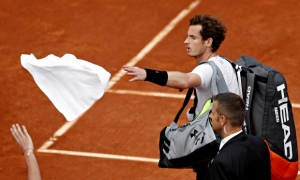 Andy Murray leaves the court after bad weather halted his French Open semi against Novak Djokovic